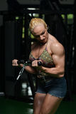 Woman Bodybuilder Doing Exercise For Biceps Stock Photo