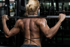 Woman Bodybuilder Doing Exercise For Legs Stock Images