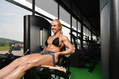 Woman Bodybuilder Doing Exercise For Legs Royalty Free Stock Photography