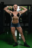 Woman Bodybuilder Flexing Muscles Royalty Free Stock Photos
