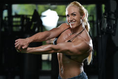 Woman Bodybuilder Flexing Muscles Stock Photography