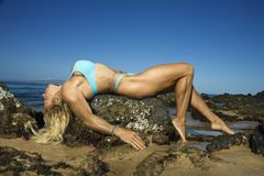 Woman bodybuilder on rock, Royalty Free Stock Photos