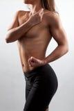 Woman bodybuilder showing muscular body Royalty Free Stock Photos