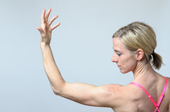 Woman bodybuilder showing off her biceps royalty free stock image