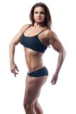 Woman bodybuilder strained muscles. Royalty Free Stock Images