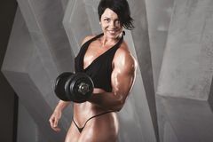 Woman bodybuilder training. royalty free stock photos