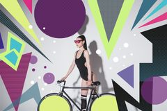 Woman in bodysuit with bicycle royalty free stock photos