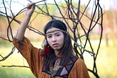 Woman with bohemian style. Portrait of asian woman with bohemian style in the field stock images