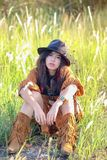 Woman with bohemian style. Portrait of asian woman with bohemian style in the field royalty free stock image