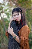 Woman with bohemian style. Portrait of asian woman with bohemian style in the field stock photography