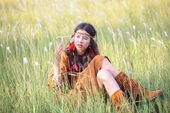 Woman with bohemian style. Portrait of asian woman with bohemian style in the field stock image