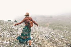 Woman in boho clothing traveling in fog weather Stock Image