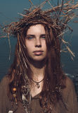 Woman in Boho Fashion with Head Wear Crown of Hay. Close up Serious Pretty Young Woman in Boho Fashion with Long Brown Hair Wearing Head Wear Crown of Hay While Stock Photography