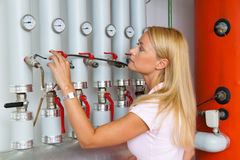 Woman in the boiler room Stock Photo