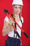 Woman with boltcutters. A young contruster woman with boltcutters Stock Image