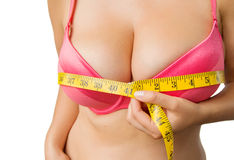 Woman with boobs measuring her bust Royalty Free Stock Image