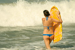 Woman with boogie board Stock Photography