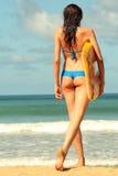 Woman with boogie board. Bikini Girl with boogie board on the beach stock photos