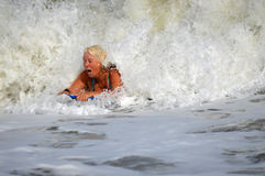 A woman boogie boarding Royalty Free Stock Image