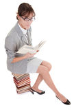 Woman and book. Business woman  in spectacles and book on white Royalty Free Stock Photography