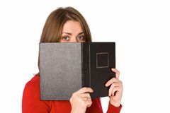 Woman with book. Woman in red with black book Stock Image