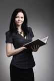 Woman with book. The business woman with book Stock Image