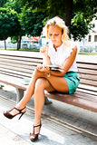 Woman with book. Beautiful and young woman reading a book in the park Stock Photo