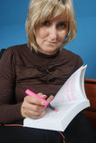 Woman with a book. Woman underlining text in a book Royalty Free Stock Photo
