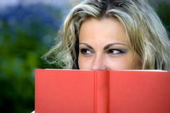 Woman with book. Beautiful young woman behind book Stock Photography