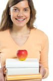 Woman, book, apple Stock Images