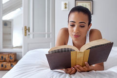 Woman book bed Stock Image
