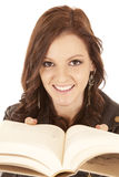 Woman book close to face smile Royalty Free Stock Photo