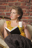 Woman with a book and a cup of tea Royalty Free Stock Image