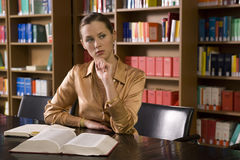 Woman With Book At Desk In Library Royalty Free Stock Photos