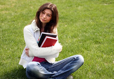 Woman with book in green grass on summer park Royalty Free Stock Photography