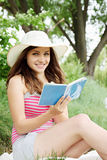 Woman with a book in hand Stock Images