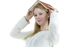Woman from book on head Royalty Free Stock Images