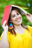 Woman with a book on her head Royalty Free Stock Photography