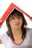 Woman with a book on her head Royalty Free Stock Photo