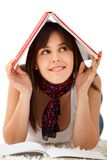 Woman with a book on her head Stock Images