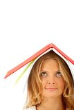 Woman with a book on her head Royalty Free Stock Image