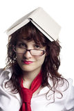 Woman with a Book on Her Head Royalty Free Stock Images
