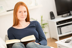 Woman with a Book at Home Royalty Free Stock Photos