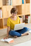 Woman with book and laptop Stock Photo