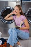 Woman With Book Listening To Music In Laundry Stock Photos