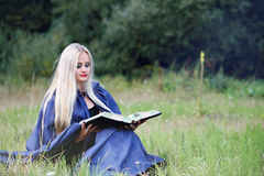 Woman with a book Stock Image