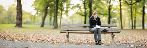 Woman with a Book and Notepad in a Park Royalty Free Stock Images