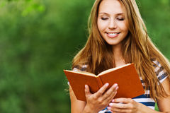 Woman with a book, read Royalty Free Stock Photo