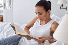 Woman book relaxing bed Stock Image