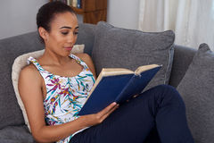 Woman book sofa couch Royalty Free Stock Photo